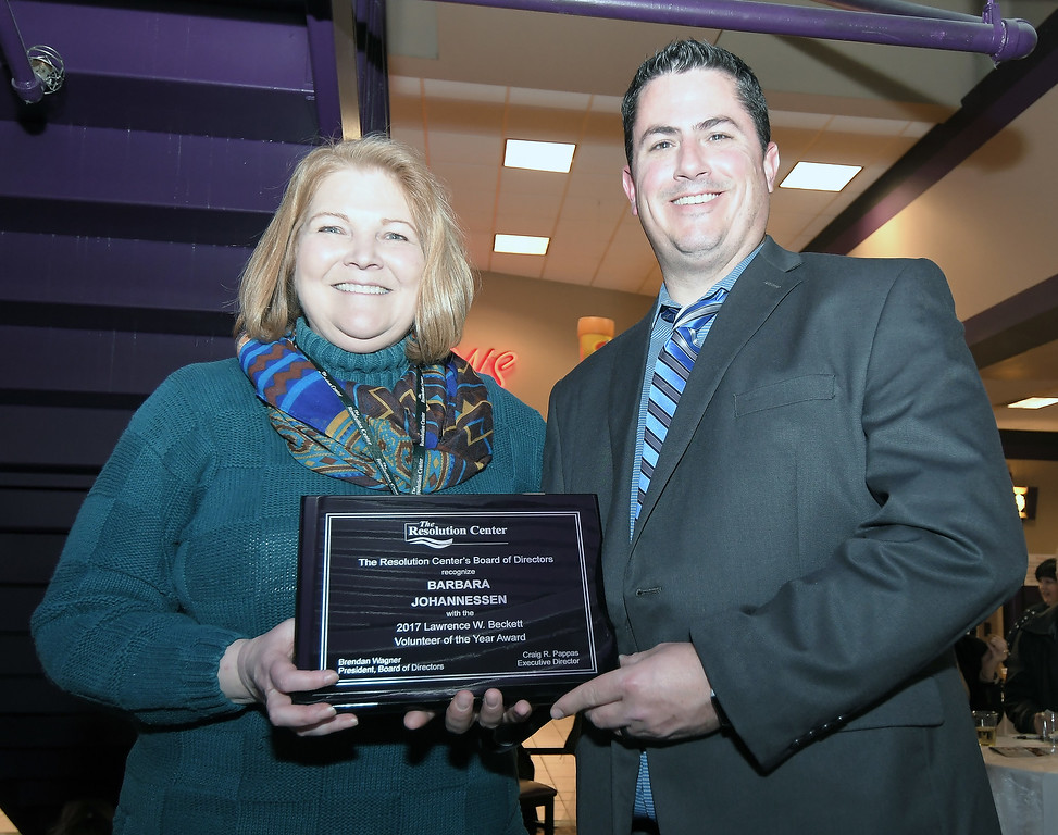 . Attorney Barbara Johannessen accepts the Lawrence Beckett Volunteer Award from Craig Pappas, The Resolution Center Executive Director. Photo courtesy of The Resolution Center