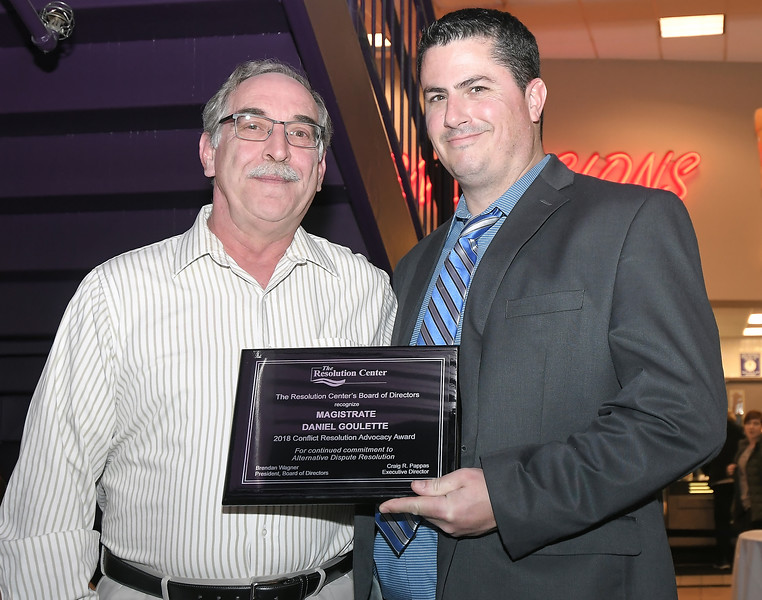 Magistrate Daniel Goulette, left, accepts the Conflict Resolution Advocacy Award from Craig Pappas, The Resolution Center Executive Director. Photo courtesy of The Resolution Center