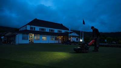 Early morning view of  the clubhouse and mowing the practice green on 26 October 2017 before  the 1st day of competition in the Asia-Pacific Amateur Championship tournament 2017 held at Royal Wellington Golf Club, in Heretaunga, Upper Hutt, New Zealand from 26 - 29 October 2017. Copyright John Mathews 2017.   www.megasportmedia.co.nz