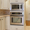 Kitchen showing convectional oven and built-in microwave.