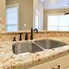 Kitchen sick with granite counter tops.