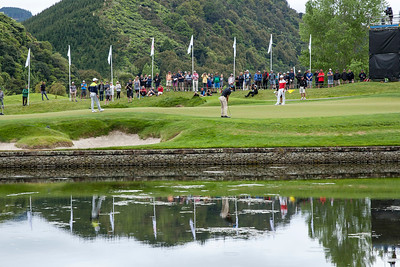 Min Woo Lee from Australia (middle) putting on the 4th green while Andy Zhang from China (left) and eventual winner Yuxin Lin from China (right) watch on the The final day of the Asia-Pacific Amateur Championship tournament 2017 held at Royal Wellington Golf Club, in Heretaunga, Upper Hutt, New Zealand from 26 - 29 October 2017. Copyright John Mathews 2017.   www.megasportmedia.co.nz