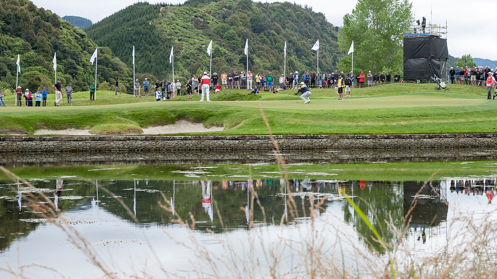 Min Woo Lee from Australia (right) line up a putt on the 4th green while Andy Zhang from China (left) and eventual winner Yuxin Lin from China (middle) watch on the The final day of the Asia-Pacific Amateur Championship tournament 2017 held at Royal Wellington Golf Club, in Heretaunga, Upper Hutt, New Zealand from 26 - 29 October 2017. Copyright John Mathews 2017.   www.megasportmedia.co.nz