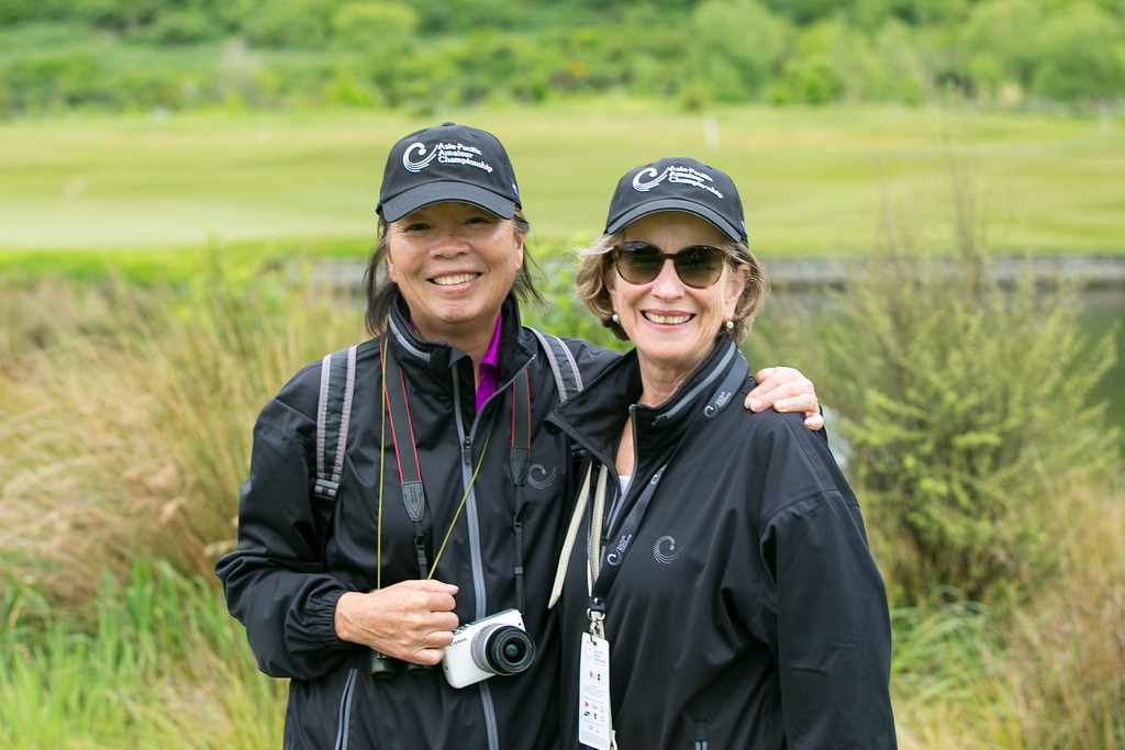 Marina Wilson and a friend stopping for a photo en route from the 4th green to the next tee on the  final day of the Asia-Pacific Amateur Championship tournament 2017 held at Royal Wellington Golf Club, in Heretaunga, Upper Hutt, New Zealand from 26 - 29 October 2017. Copyright John Mathews 2017.   www.megasportmedia.co.nz