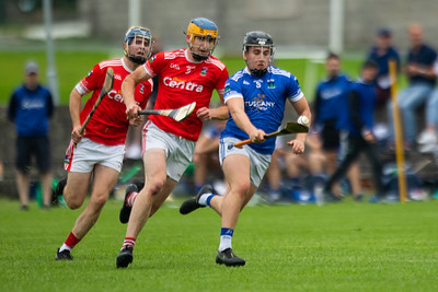 Ballina's Sam Loughran is followed by Gortnahoe Glengoole's Jack Moore and Karl Campion during the 'FBD Insurance' Seamus O'Riain Cup round 1 in Borrisoleigh.