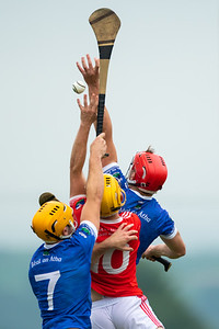 Gortnahoe Glengoole's Fionn Cleary goes high against Ballina's Mike Grace and Stephen O'Brien during the 'FBD Insurance' Seamus O'Riain Cup round 1 in Borrisoleigh.
