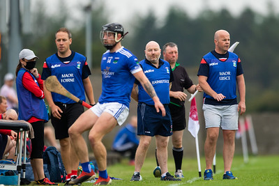 Ballina's Aidan Hanly is watched on by Gortnahoe Glengoole's management team during the 'FBD Insurance' Seamus O'Riain Cup round 1 in Borrisoleigh.