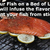 Grill Your Fish on a Bed of Lemons<br /> It will infuse the flavor and prevent your fish from sticking.