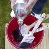 Add Vinegar to a bucket to clean your paint brushes!!  No more expensive turpentine needed.