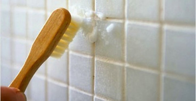 Baking Soda: Clean Bathroom Grout  How to do it: Make a paste of water and baking soda. Using a small brush or toothbrush, rub the paste onto stained or dirty grout. Let sit for three minutes and rinse.