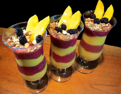 Dinner Parfait TO LIVE FOR! Jackfruit's in season, blended with guanabana, mango, mora berries, vanilla, coconut oil, for a smooth, fruity, parfait garnished with almonds, mango, mora berries. Yummy end to a hot tropical day at Jewel of the Sun (from Eric Rivkin)