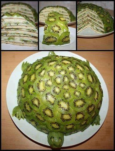 """Fruity Turtle Cake from:Live Love Fruit RECIPE: Peeled, and thinly sliced kiwis (as many as it takes to cover shell) Bananas, thinly sliced, lengthwise Coconut flesh (1/2 cup) Coconut water (1/4 cup) Dates, pitted (1/2 cup)  1. Put coconut flesh, coconut water, and dates into a blender, and blend on high until you get an """"icing"""" like consistency (not too liquidy, if it is too thin, add more dates)  2. Start with layered bananas on the bottom, followed by some coconut date """"icing"""", followed by thinly sliced kiwi rounds, and then some more """"icing"""", and then more banana slices. Continue this pattern, moving slowly into the center until you get a 1/2 circle shape on your plate.  3. Next, layer the 1/2 circle with thinly sliced kiwi rounds to make the green colour of the turtle shell.  4. Make the head, feet, and tail, simply by carving out individual kiwis to get the shapes as pictured in the picture below."""