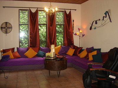 Livingroom 1 - Our cozy Conversation Corner!!  Sink yourself into this (it's really 3 twin mattresses with LOTS of pillows so you can imagine how COMFY it is!!!!)!!!   Other FREE goodies and services:    Concierge / Reservationest and an EXCELLENT Resource Center Business Center!   Meeting Space.  Message Center.    Cable TV with many English-Speaking and U.S. TV Stations (in Common Areas).    LIBRARY with Lots of Books, CDs, Tapes, DVDs, Videos and Games to Enjoy.    Hammocks to hang and just BE!!   We provide Umbrellas & Flashlight to use while with us.  FREE Parking!!  FREE Storage!!  And LOTS MORE!!   (some free amenities are not available with discounted stays)