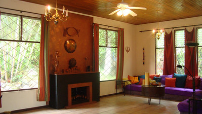 Our beautiful art piece (the wall hanging and the painting [done as a help/trade/stay project]) ties in together the whole room while you get to look out at the LUSH TROPICAL grounds!  We have LOTS of candle holders throughout this room as well as Mood Lighting!  Sorry, it's not a functioning fireplace.  Feng Shui Master Alejandro from Argentina/Peru suggested doing the black paint on the base of the fireplace.  It's growing on me!!