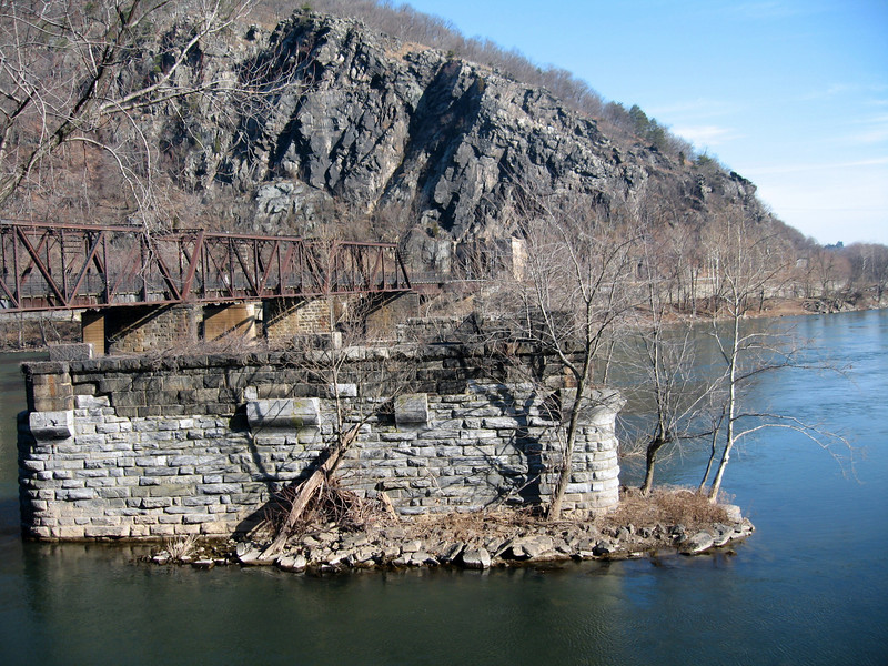 Potomac River and railroad at Harpers Ferry.  This railroad track was build in the mid 1850's to provide for shipping of armory weapons and supplies.  Eventually Harpers Ferry became a source of weapons for the Confederates during the Civil War.