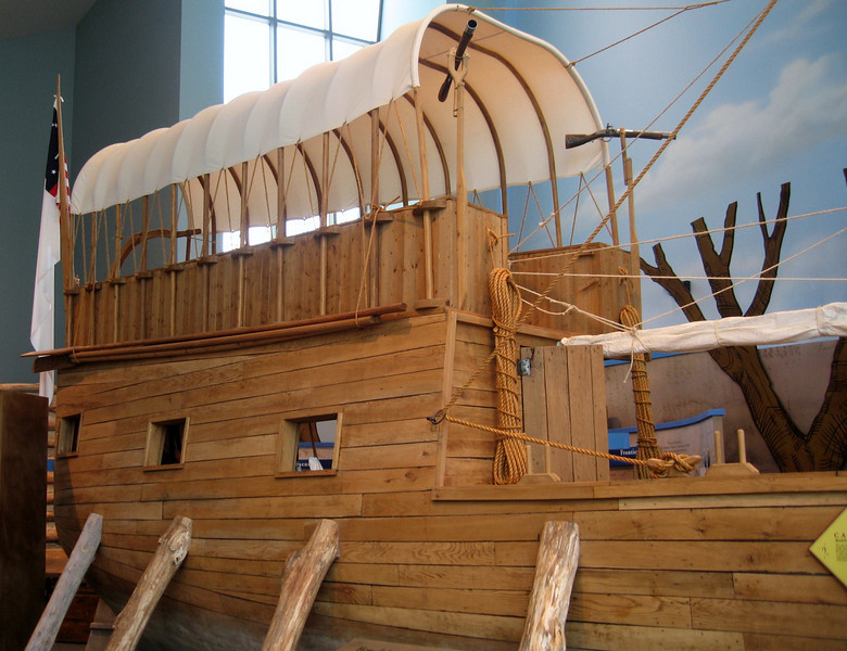 Keelboat replica.  Note the monocular and rifle mounted at the top of the captains' quarters.  It is realistic that these were accurate representations. Not illustrated in any of these pictures the keelboat was mounted with a small canon. This canon was relatively useless as a weapon but was mostly used to scare the Indians with its loud booming sound.
