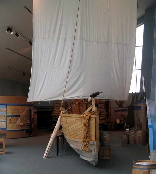 Pirogue with sail raised.  Due to hanging limbs and lack of wind the sail was rarely used on the route to Fort Mandan.  The pirogues were propelled by rows, sail, poles and often by leather and hemp ropes.