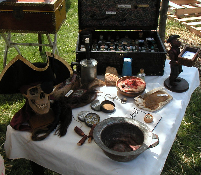 Medical tools and drug chest in the background.  The drugs of this era were primarily herbs. both Clark and Lewis, especially Lewis, were knowledgable of herbal cures used during the Expedition when they had occassionals ailment and injuries.
