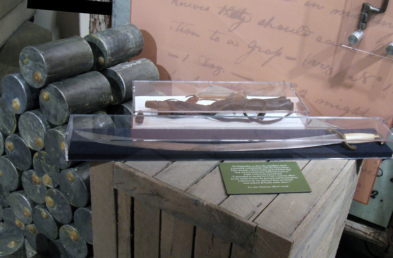 Sword and replica lead canisters (on left of picture) used to store gunpowder.  The canisters had a wax plug to keep them waterproof.  Lewis used lead for three reasons: 1) The canisters were relatively waterproof, 2) The heavy canisters would instantly sink from a tipped over canoe, 3) The lead canisters could be melted down into bullets when empty.