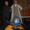 """Pistons & Fenders"" Charity Event at the Coker Museum in Chattanooga 2/4/2012. Handing over the mike to our host for the evening Corky Coker."
