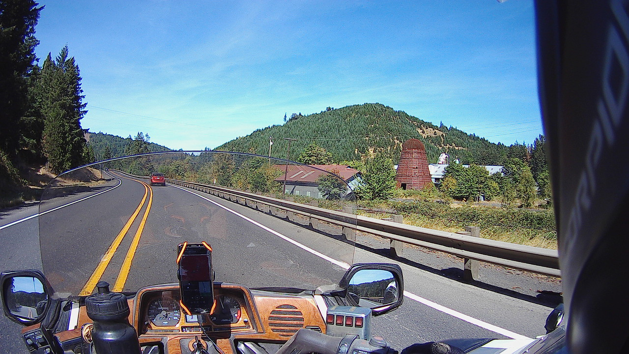 motorcycle on road highway oregon lumber wigwam burner