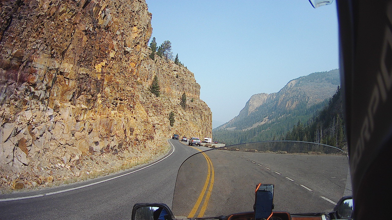 motorcycle POV cliff mountain highway