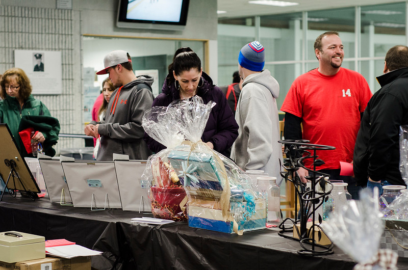 Guests purchase raffle tickets during the 2nd Annual Brad Cutting Memorial Ice Hockey Game at the Wallace Civic Center in Fitchburg on Saturday, March 25, 2017.  Cutting was just 20-years-old when he died in a two-car accident on November 27, 2015. SENTINEL & ENTERPRISE / Ashley Green