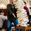 Keith Scott catches the blocks while playing giant Jenga during Oktoburgfest at the Fitchburg Senior Center on Saturday afternoon. SENTINEL & ENTERPRISE / Ashley Green