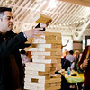 Guests play giant Jenga during the second annual Oktoburgfest at the Fitchburg Senior Center on Saturday. SENTINEL & ENTERPRISE / Ashley Green