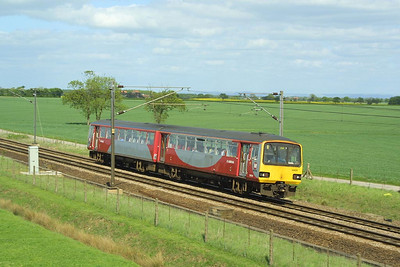 144011 works a York-Hull service at Colton Jnct on 07/05/2003.
