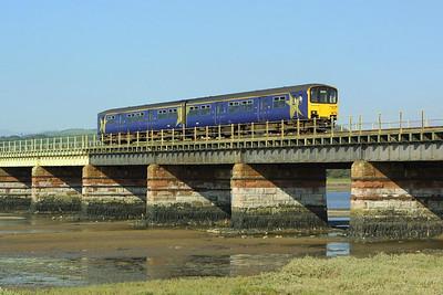 150147 forms 2C47 1411 Peston-Sellafield as it crosses Eskmeals Viadut on 09/09/2004.
