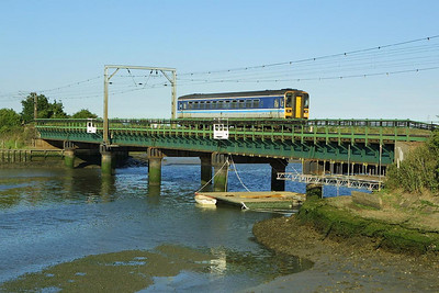 155306 slows for Manningtree North Jnct as it crosses Manningtree Viaduct with 2A73 1704 Cambridge-Harwich International on 06/07/2004.