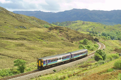 156499 is pictured leaving Morar on Sunday 18/05/2003 working the 1205 Fort William-Mallaig service.