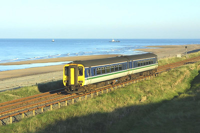 156425 catches the early morning sun at Seascale on 09/09/2004 whilst working 2C36 0727 Whitehaven-Barrow in Furness.