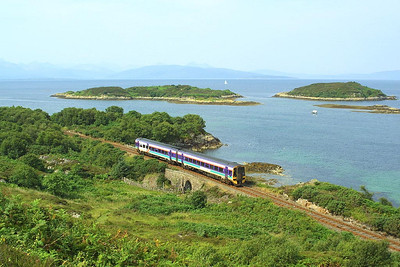 An unidentified Class 158 unit passes the picturesque location of Erbusaig shortly after departing from Kyle of Lochalsh with an Inverness service on 01/08/2002.