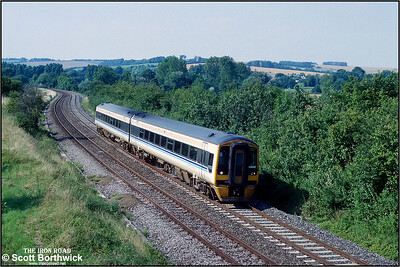 158869 passes Sherrington whilst forming the 1430 M-Sa Cardiff Central-Portsmouth Hrabour service on 31/07/1992.