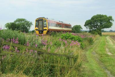 158905 heads east at Elsham Carrs on 26/07/2002.