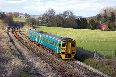158837 approaches Craven Arms on 13/04/2006 with 1V61 1435 Holyhead-Cardiff Central.