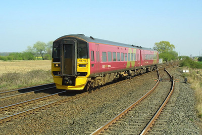 158742 works a Manchester Airport bound service at Hagg Lane Crossing, Gascoigne Wood on 17/04/2003.
