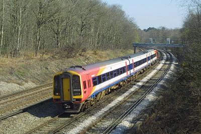 159008 heads southwards near Pirbright Junction on 04/04/2003.