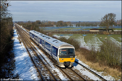 As the snow melted the inevitable floods were to follow. The River Ray can be seen overflowing into the fields around Piddington and Blackthorn as 165029 nears Piddington whilst forming 1H28 0942 Stratford upon Avon-London Marylebone on 11/02/2009. 165005 can be seen in the distance forming 1N20 0954 London Marylebone-Bicester North.