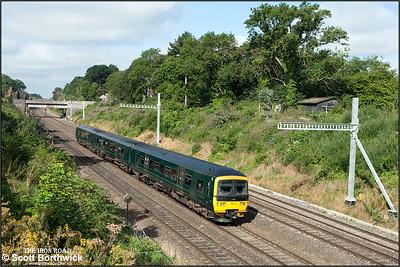 166212 forms 1K41 0843 Bedwyn-London Paddington as it exits Sonning cutting on 12/08/2016.