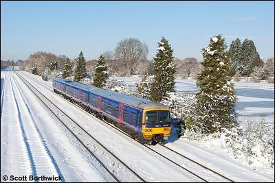 166215 passes Hinksey whilst forming 1P41 1201 Oxford-London Paddington on 07/01/2010.