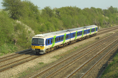 166202 approaches Didcot in South Moreton Cutting on 10/04/2002 with a service from London Paddington.