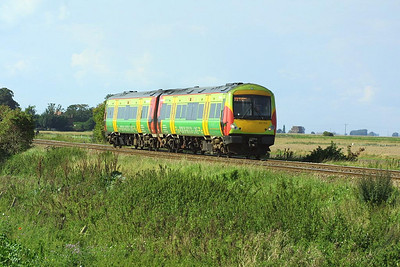 170513 approaches Welney Road LC, Manea on 21/08/2004 whilst forming 1L18 1327 Birmingham New Street-Stansted Airport.