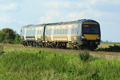 'Birmingham Bull Ring' liveried 170505 crosses Cow Common as it approaches Welney Road LC, Manea on 21/08/2004 whilst working 1L20 1427 Birmingham New Street-Stansted Airport.