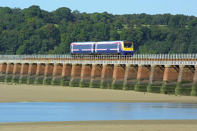 175011crosses Kent Viaduct, Arnside with 1C59 0949 Manchester Airport-Barrow in Furness on 08/09/2004.