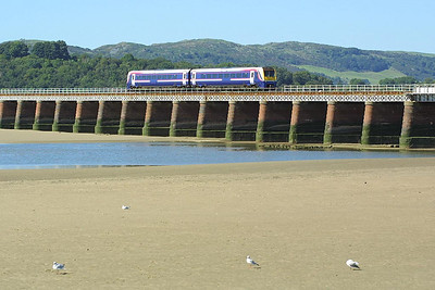 175011 crosses Kent Viaduct, Arnside on 08/09/2004 whilst working 1H61 1249 Barrow in Furness-Manchester Airport.