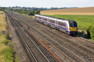 180113 runs ECS to London Paddington at Manor Farm, Cholsey on 11/07/2005. This working was as a result of Oxford station being evacuated due to a suspect package being found aboard a Virgin Cross Country service at Oxford.