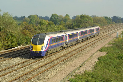 180106 heads west at Denchworth on 18/10/2002 with a service from London Paddington.